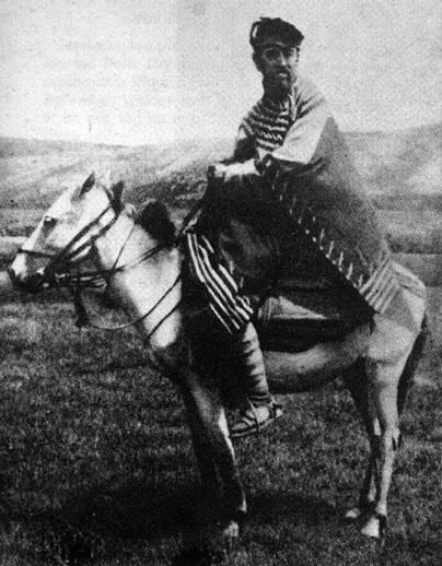 Portrait of Occultist Aleister Crowley Sitting on Donkey. Aleister Crowley is shown riding a donkey on the Deosai Plateau at the time of his first Himalayan Expedition.
